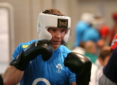 Gordon D'Arcy spars with some of Team Ireland's boxers last week.