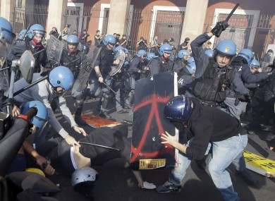 Police clash with demonstrators during a protest against Italian Government austerity measures in Rome, Wednesday, Nov. 14, 2012.