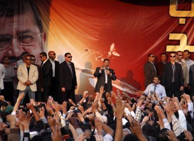 Egyptian President Mohammed Morsi speaks to supporters outside the Presidential palace in Cairo, Egypt, Friday, Nov. 23, 2012.