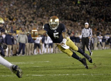 Notre Dame quarterback Everett Golson dives into the end zone in front of Pittsburgh linebacker Joe Trebitz for a two-point conversion to tie the game late in the fourth quarter.