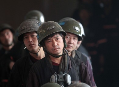 File photos of mine rescue workers in  Henan Province