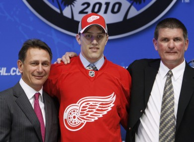 Riley Sheahan, centre, flanked by Detroit Red Wings general manager Ken Holland, left, and Joe McDonnell, director of amateur scouting, at the 2010 NHL hockey draft (file photo).