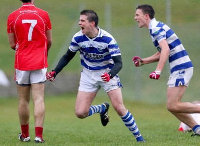 Castlehaven's Seanie Cahalane celebrates scoring his side's goal along with teammate Mark Collins.