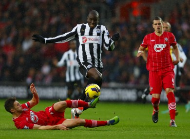 Newcastle's Demba Ba (centre) in action against Southampton's Adam Lallana during the Barclays Premier League match at S