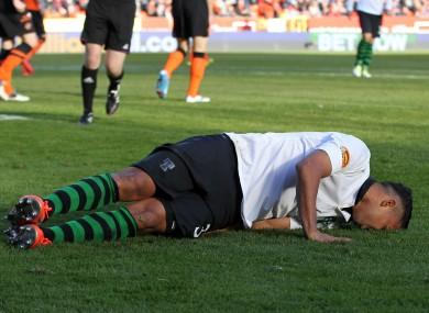 Celtic's Emillio Izaguirre in pain against Dundee United.
