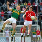 Aerial contest. Cork's Aidan Walsh and Johnny Buckley of Kerry battle for possession. By the finish Walsh is celebrating a five-point win. (INPHO/Lorraine O'Sullivan).