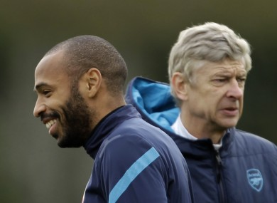 Henry (left) and Wenger during his time with the Gunners