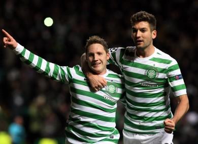 Kris Commons and Charlie Mulgrew celebrate the winning goal.