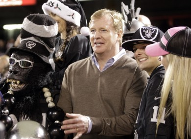 NFL commissioner Roger Goodell watches a game with Oakland Raiders fans last week.