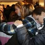 Girls embraces outside St Rose of Lima Roman Catholic Church, which was filled to capacity, during a prayer service held in for victims of the shooting in Newtown. (AP Photo/Charles Krupa)
