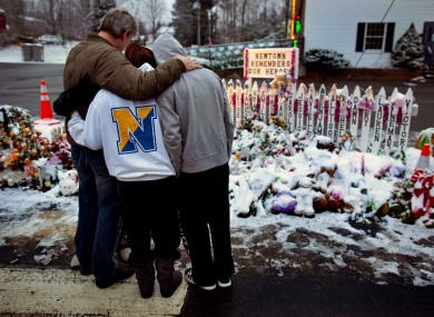 Members of the Rutter family of Sandy Hook, Conn., embrace early Christmas morning as they s