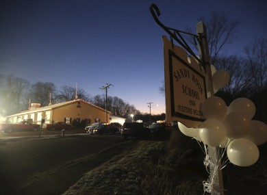 White balloons decorate a sign for the Sandy Hook Elementary School, early this morning.