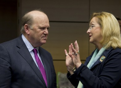 Finance Minister Michael Noonan, left, speaks with Austria's Finance Minister Maria Fekter during a meeting of EU finance ministers in Brussels on Wednesday.