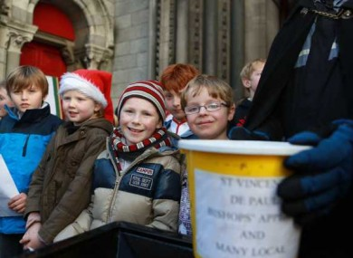 Children from Kildare Place School singingfor the annual Black Santa Christmas charity.