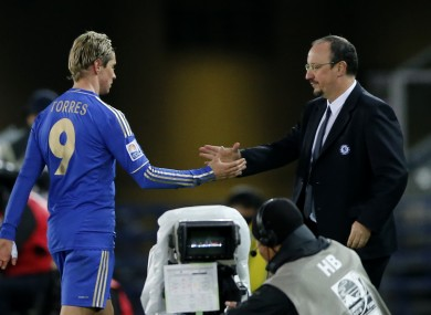 Torres is congratulated by manager Benitez during the semi-final.