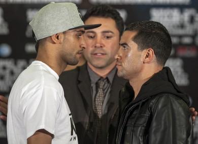 "Golden Boy Promotions president Oscar De La Hoya, centre, presents Amir ""King"" Khan, left, and his opponent, Carlos Molina."