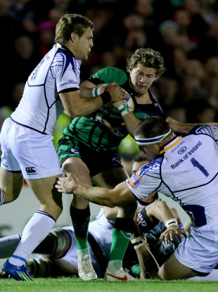 Kieran Marmion of Connacht is tackled by Leinster's Ian Madigan.