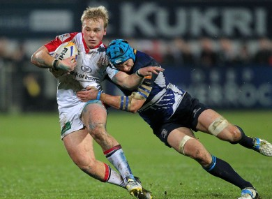 Luke Marshall tries to brush off Kevin McLaughlin in his side's 27-19 win.