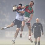 Struggling to see. McHale Park is cloaked in heavy fog as Dublin's Ross McConnell and Mayo's Aidan O'Shea battle for possession. The game is eventually abandoned by referee Marty Duffy and is refixed for March 31st when Mayo stroll to a 0-20 to 0-8 success. (INPHO/James Crombie).