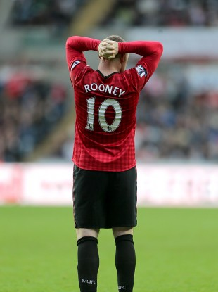 Manchester United's Wayne Rooney appears dejected after being substituted.