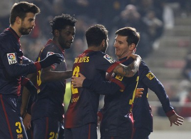 Barcelona's Lionel Messi, right, celebrates with teammates Daniel Alves, second right, Alexandre Song, second left, and Gerard Pique, left.
