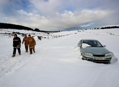 Dublin Civil Defence members in snow drifts in Wicklow on 13 January 2010.