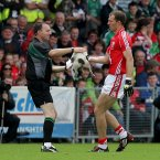 But it is Cork's Alan O'Connor who steps in to clear the pitch and offloads to the linesman.