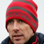 You have to make sure to put on a warm hat. Anthony Rainbow's red North Face offering is a departure from the traditional black number beloved of GAA managers.