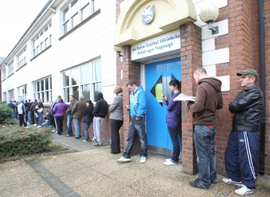 Unemployed people wait to sign on at a Social Welfare office in Finglas. 187,144 people have been on the Live Register for over twelve months.