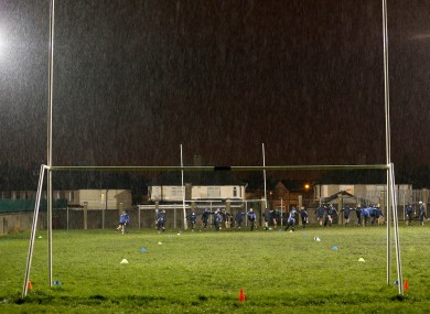 Dublin players warm down after the game was called off.