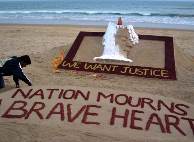 Sand artist Sudarshan Pattnaik creates a sculpture to pay homage to the gang rape victim who died last Saturday in hospital.