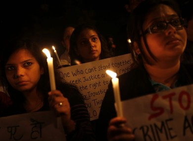 Indian students participate in a candlelight vigil to mark the passing of a month since a gang rape of a 23-year-old student in a bus, in New Delhi