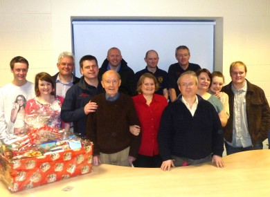Jack Healy, centre, with family and members of the APFS crew who helped save him in Dublin Airport.