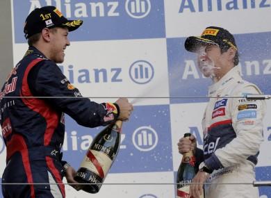 Formula 1 driver Sebastian Vettel, of Germany, sprays champagne into the face of Sauber's Kamui Kobayashi after the 2012 Japanese Grand Prix.