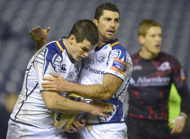 Jonathan Sexton is congratulated by Rob Kearney after his try.