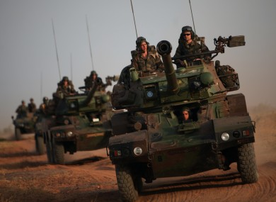 French soldiers patrol in armored vehicles, in the outskirts of Sevare, Mali.