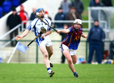 Michael Walsh of Waterford in action against Paraic Walsh of UL.