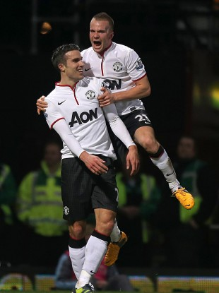 Robin van Persie celebrates with Tom Cleverley.