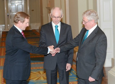 Enda Kenny, Herman van Rompuy and Eamon Gilmore shake hands (awkwardly) after their meeting in Dublin Castle.