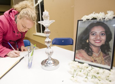 A woman signs a book of condolence for Savita Halappanavar in Galway in November.