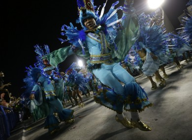 Performers from the Unidos de Vila Isabel samba school parade during Carnival celebrations at the Sambadrome in Rio de Janeiro