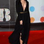 Jessie J also wore a long black dress with a gold belt.  Someone needs to have a word with her, by the way, doesn't she know that her fringe is the source of all her power?  Doug Peters/Doug Peters/EMPICS Entertainment