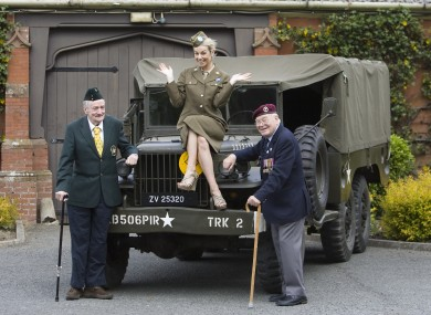 Irish World War II veterans, Captain James Riordan and Sergeant Johnny Wetherall - and model Pippa O'Connor - pose in 2010. Legislation introduced today will formally pardon Irish Army staff who deserted to fight with the Allies in WW2.