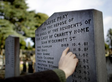 A man looks at a burial plot for victims of the Magdalene Laundries in Glasnevin Cemetery, Dublin.