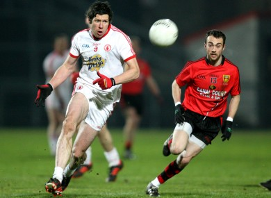 Sean Cavanagh of Tyrone and Conor Laverty of Down.