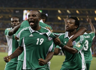 Nigeria's Sunday Mba, front, celebrates scoring against Burkina Faso in Nigeria's African Cup of Nations tournament final soccer match at Soccer City Stadium.
