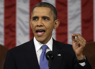 President Barack Obama gestures as he gives his State of the Union address.