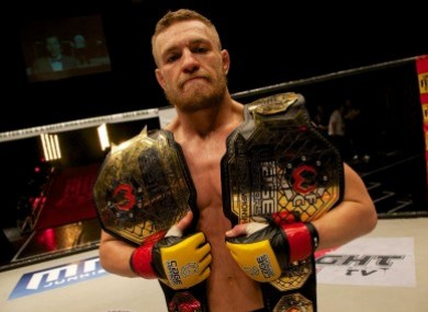 Conor McGregor with his 2 Cage Warrior belts.