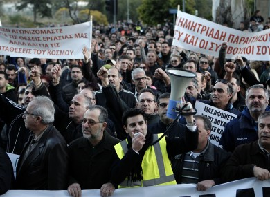 Bank employees protest outside the Ministry of Finance yesterday, demanding clarity on the future of their jobs and opposing a deposit levy.