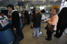 With limits on cash withdrawals, Cypriot banks reopen calmly